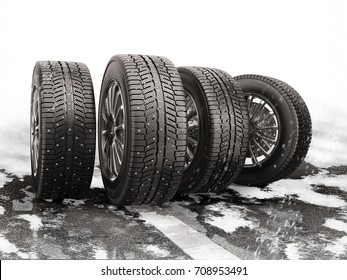 Four car tires rolling on a snow-covered road. 3d illustration.