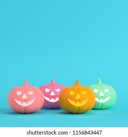 Four colorful halloween pumpkins, jack o lantern on bright blue background in pastel colors. Minimalism concept. 3d render