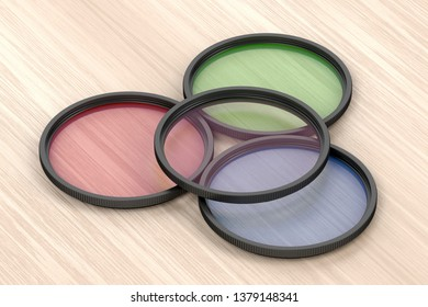 Four different photographic filters on wood background, 3D illustration