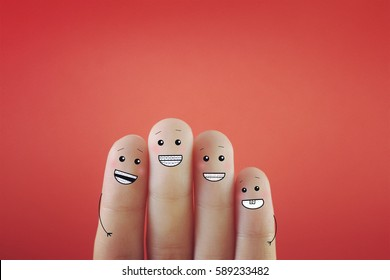 Four fingers decorated as four person wearing braces. Suitable for anything about orthodontics.