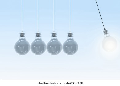 Four swinging lights against dark bulb- 3d illustration