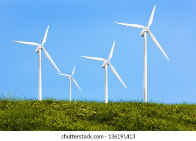 Four turbines on the grass against blue background