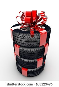 Four tyres with a red ribbon like a present