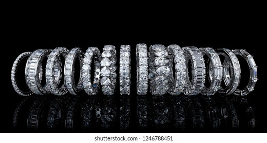 Fourteen  various diamond eternity rings in line on black glossy background. 3D illustration