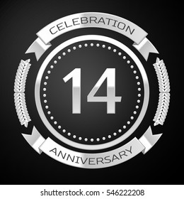 Fourteen years anniversary celebration with silver ring and ribbon on black background.
