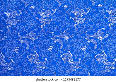 Fragment of blue chinese silk with dragons and flowers