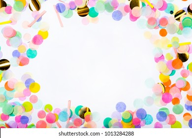 Frame made of colorful confetti on white background. Color party background. Top view. Flat lay