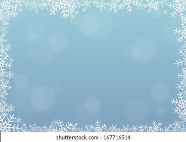 Frame made of snowflakes on blue background with some bubbles in bokeh effect