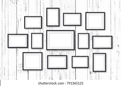 Frames collage, thirteen pieces set on white painted wooden wall. Interior decor mockup, 3d illustration