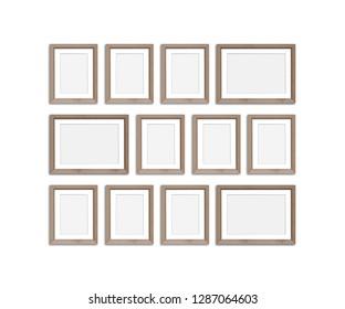 Frames collage, twelve blank wooden frameworks isolated on white background, gallery style mockup. 3D illustration