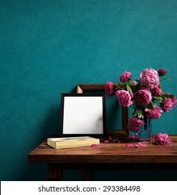 Frames and flower vase on color wall - 3D rendering