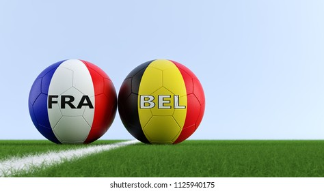 France vs. Belgium Soccer Match - Soccer balls in France and Belgium national colors on a soccer field. Copy space on the right side - 3D Rendering