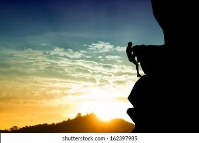 Free climbing man at sunset