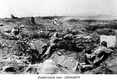 A French assault on German positions (in foreground trench). As the moving attackers, the French troops are very vulnerable to shots from the entrenched Germans. Champagne, France. WWI. 1917.