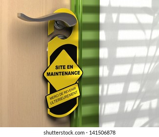 "French concept. Door hanger with the word ""Site en maintenance"". Concept for internet website"