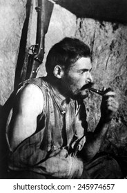 French WWI soldier smoking a pipe and resting after battle. 1914-1918.