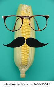 Fresh corn with hipster character