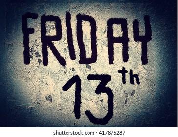 Friday 13th writing on black grunge background