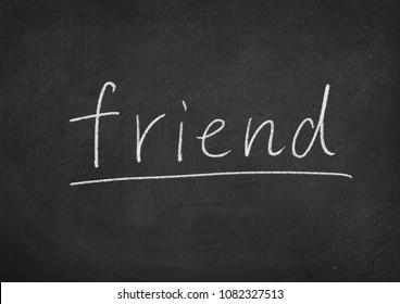 friend concept word on a blackboard background