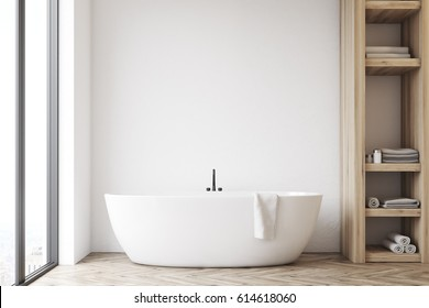 Front view of a bathroom interior with a white tub, a wooden closet and white wall. 3d rendering, mock up