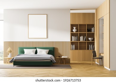 Front view of a bedroom with king size bed, a bookshelf, a table and a chair. Large vertical poster is hanging above the bed. 3d rendering. Mock up.