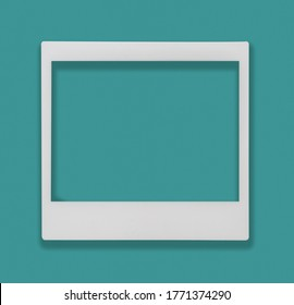 Front view of a blank Polaroid photo frame with copy space. The center can easily been cut out and replace by a photo.