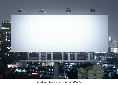 Front view of empty banner on illuminated night city background. Advertisement concept. 3D Rendering