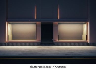 Front view of empty storefront at night. Mock up, 3D Rendering