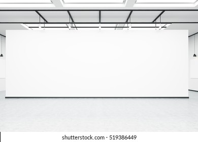 Front view of an empty white wall in a room with concrete floor in an art gallery or exhibition hall. 3d rendering. Mock up