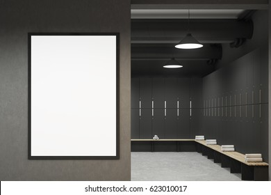 Front view of a gray locker room with benches along the rows of lockers. There is a vertical framed poster on a wall. 3d rendering, mock up