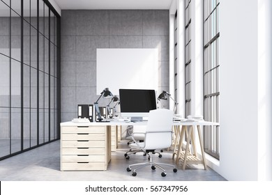 Front view of a loft office with rows of wooden table. There are desktops standing on them. Tall windows. 3d rendering. Mock up.