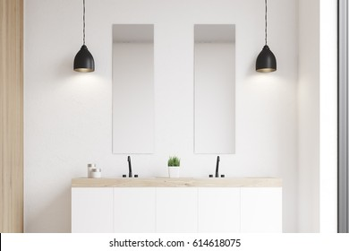 Front view of a modern beautiful bathroom with a long white double sink. The wall is white. 3d rendering