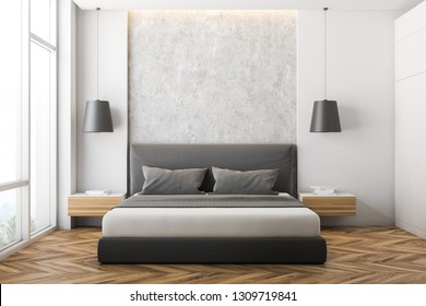 Front view of modern bedroom with white and stone walls, wooden floor, large window, gray master bed with wooden bedside tables and white wardrobe. 3d rendering