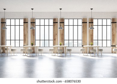 Front view of a modern cafe interior with concrete walls and floor, wooden shutters at tall windows and round tables with chairs. 3d rendering mock up