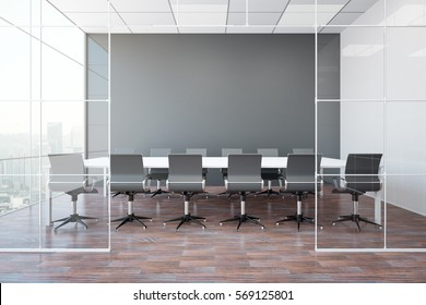 Front view of modern meeting room with blank grey wall, wooden floor, city view and daylight. Mock up, 3D Rendering