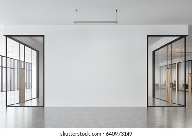 Front view of an office corridor with glass and white walls, concrete floor and panoramic windows with a cityscape seen through them. 3d rendering, mock up