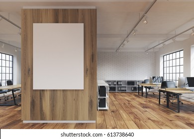 Front view of an office with a poster hanging on a wooden wall, rows of tables with computers and wooden floor. 3d rendering. Mock up