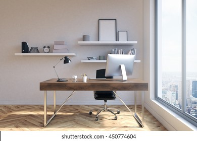 Front view of office workplace with blank picure frames on shelves, desk with computer and other items, wooden floor, concrete wall and window with New York city view. 3D Rendering