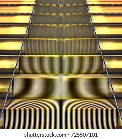 Front view on a golden escalator. 3d illustration