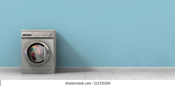 A front view of a regular brushed metal washing machine filled with clothing in an empty room with a shiny tiled floor and a baby blue wall
