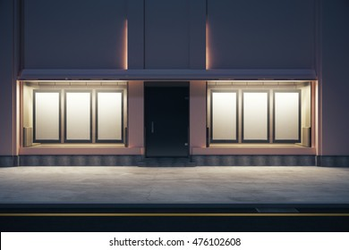 Front view of storefront with numerous empty posters at night. Mock up, 3D Rendering