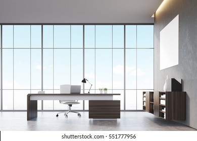 Front view of a sunlit CEO office with wooden furniture, large panoramic window and a horizontal poster on a gray wall. 3d rendering. Mock up.