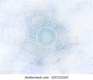 Frosty mandala mystic abstract background in light blue color. Winter mood backdrop.