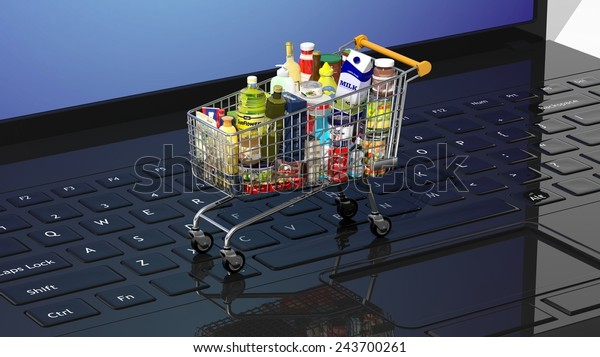 Full with products supermarket shopping cart on black laptops keyboard