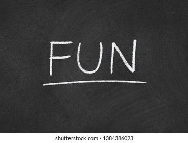 fun concept word on a blackboard background