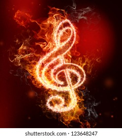 G clef in fire on red and black background
