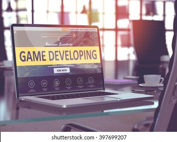 Game Developing Concept Closeup on Laptop Screen in Modern Office Workplace. Toned Image with Selective Focus. 3D Render.