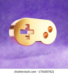Gamepad icon. Gold glossy joystick symbol isolated on violet velvet background. Modern icon for website, social media, presentation, design template element. 3D render.