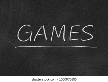 games concept word on a blackboard background