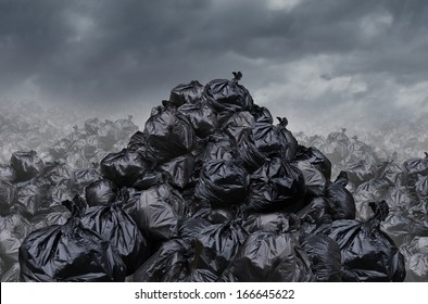 Garage dump concept as mountains of black trash bags with an unpleasant smell  in an infinite landfill heap landscape as a background of environmental damage issues on a foggy  dark cloudy scene.